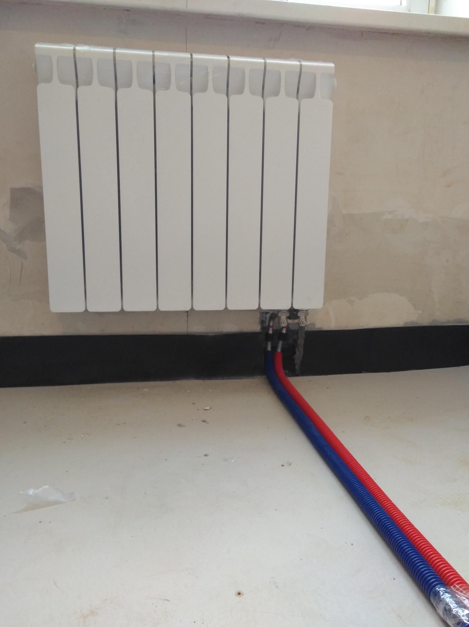 montazh-radiatorov-otopleniya-07